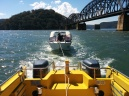 Towing a vessel from the railway bridge to the Brooklyn fuelling pontoon